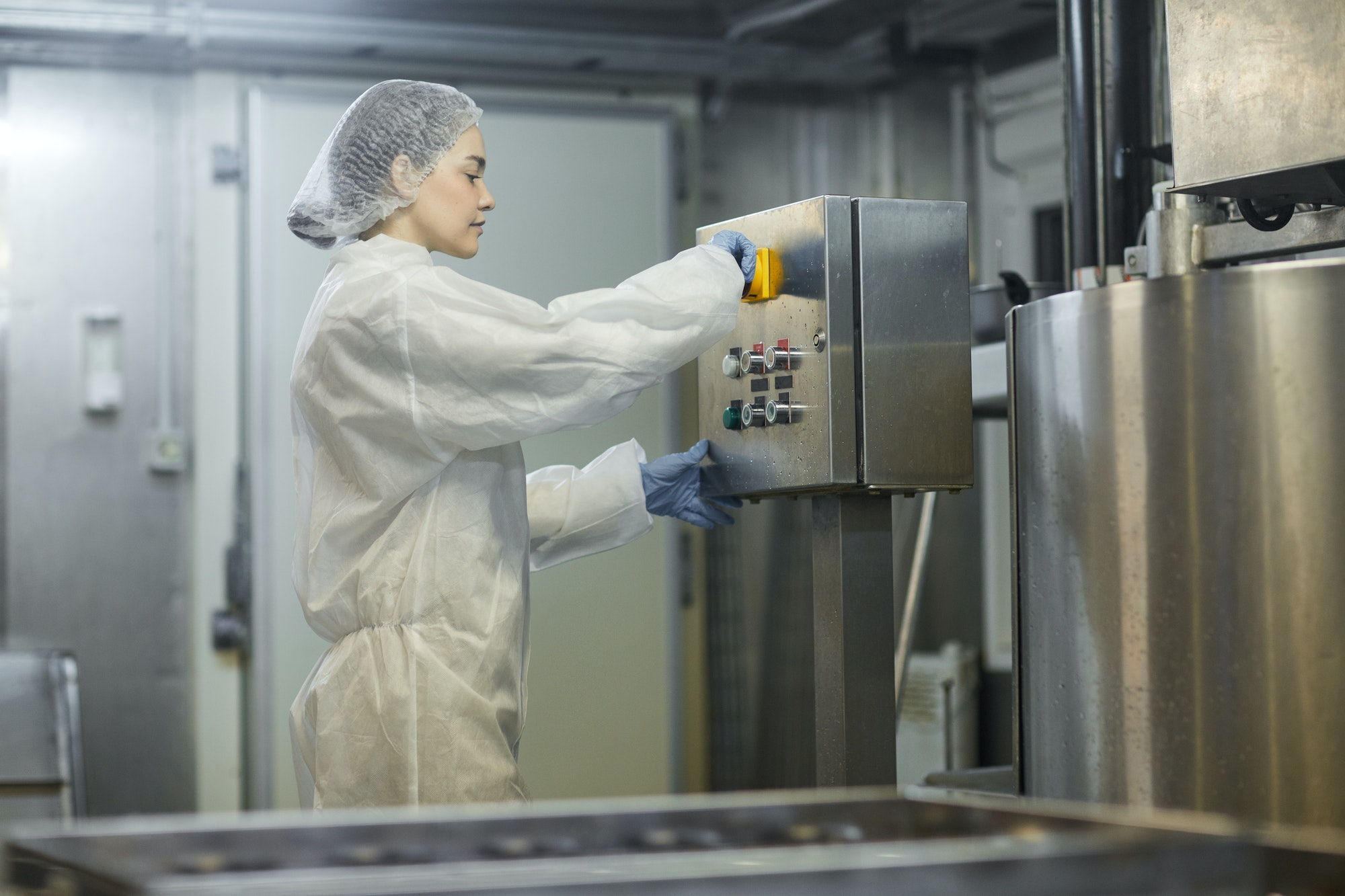 Female Worker at Industrial Factory